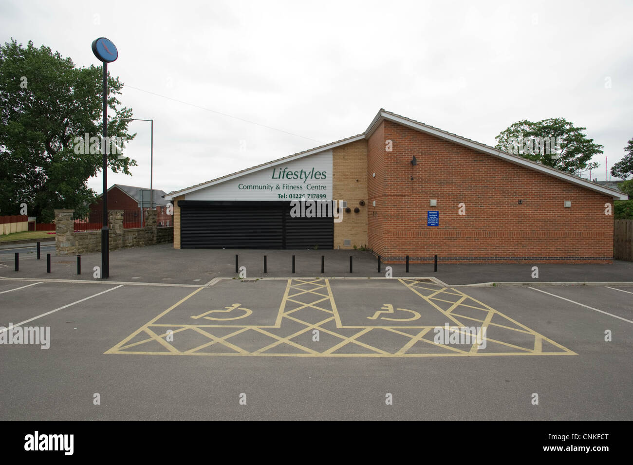 Disabled parking spaces outside a LifestayleCommunity centre - Stock Image