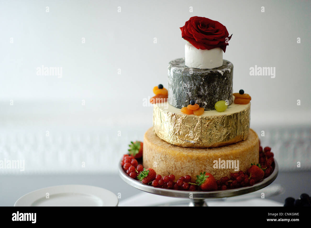 four tier round wedding cake cheese tower - Stock Image