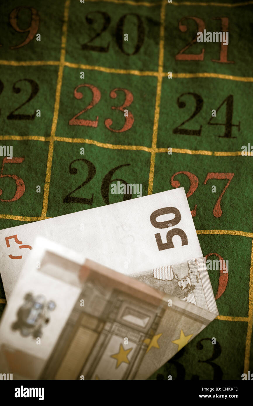 a 50 EUR note on a roulette table - Stock Image