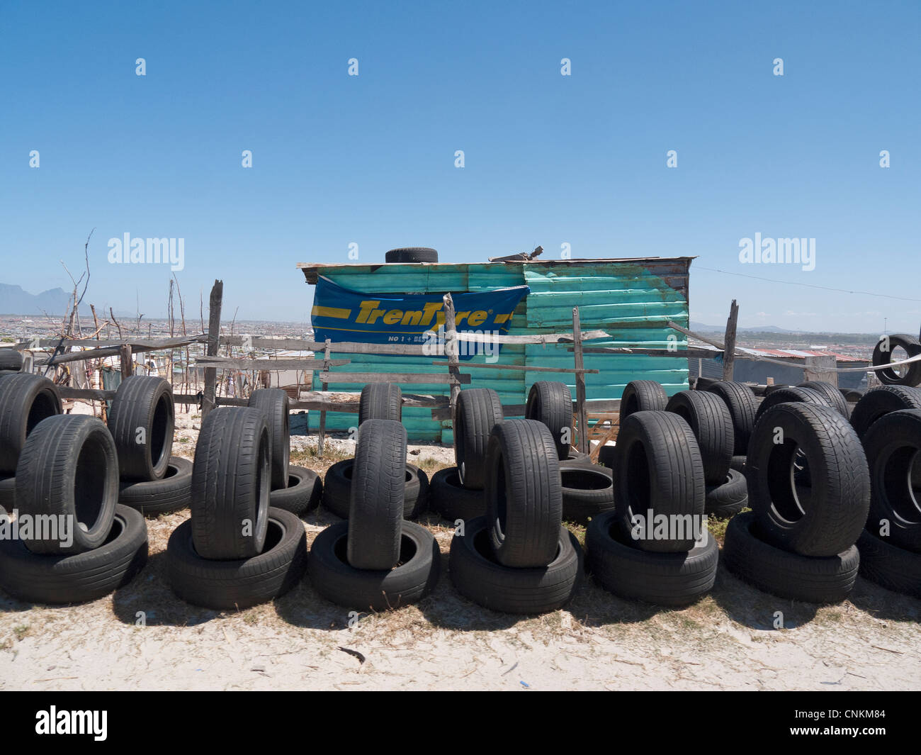 Secondhand car tyres on sale in the Khayelitsha township Cape Town S Africa - Stock Image