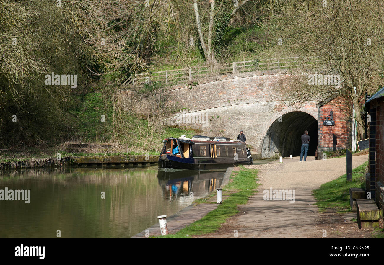 Grand Union Canal narrowboat exiting the 3076 yard long Blisworth Tunnel at Stoke Bruerne Northamptonshire England - Stock Image