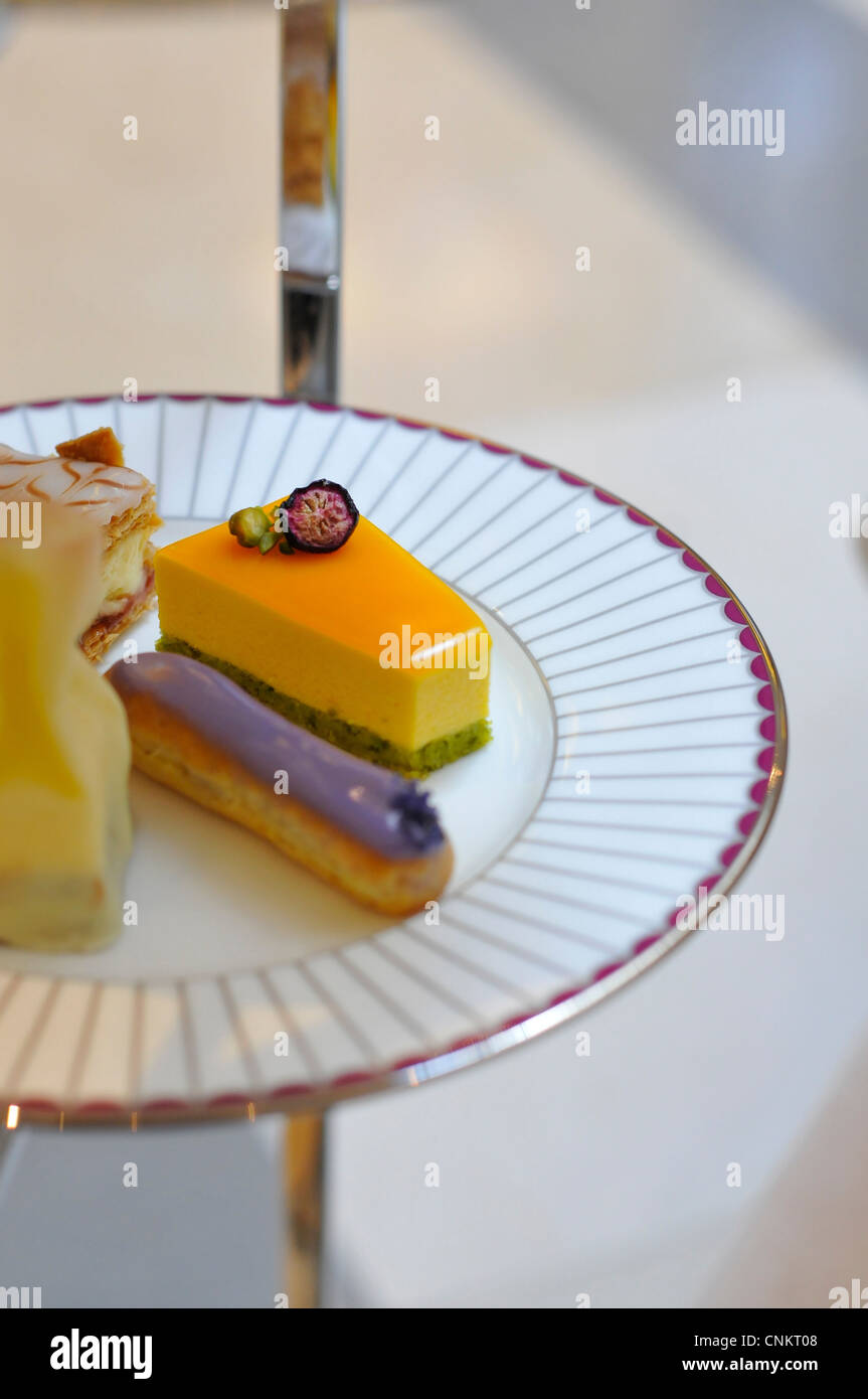 Afternoon Tea cakes at The Corinthia Hotel, London, England, UK - Stock Image
