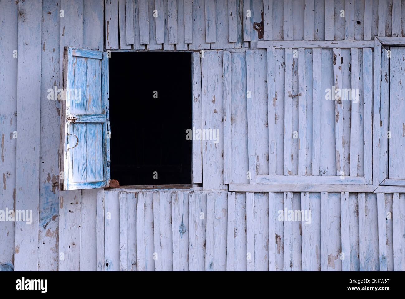 Open Window hatch in a wooden wall. Kalaw, Burma - Stock Image