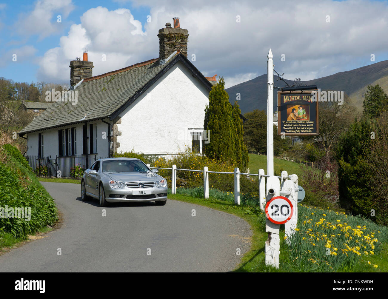 Sign for the Mortal Man pub in the village of Troutbeck, Lake District National Park, Cumbria, England UK - Stock Image