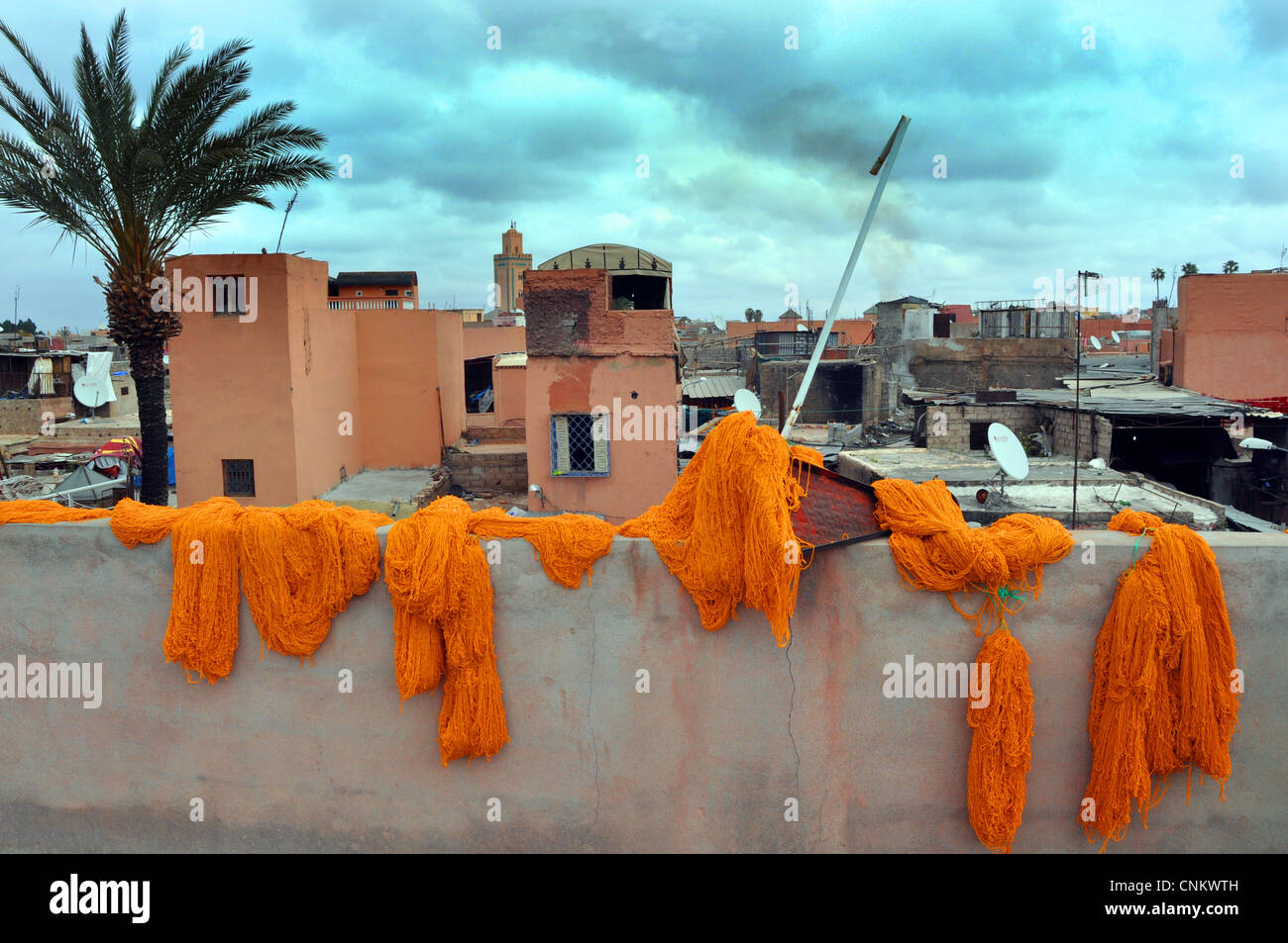 Traditional Wool dye process in the Souks of Marrakesh, Morocco Stock Photo