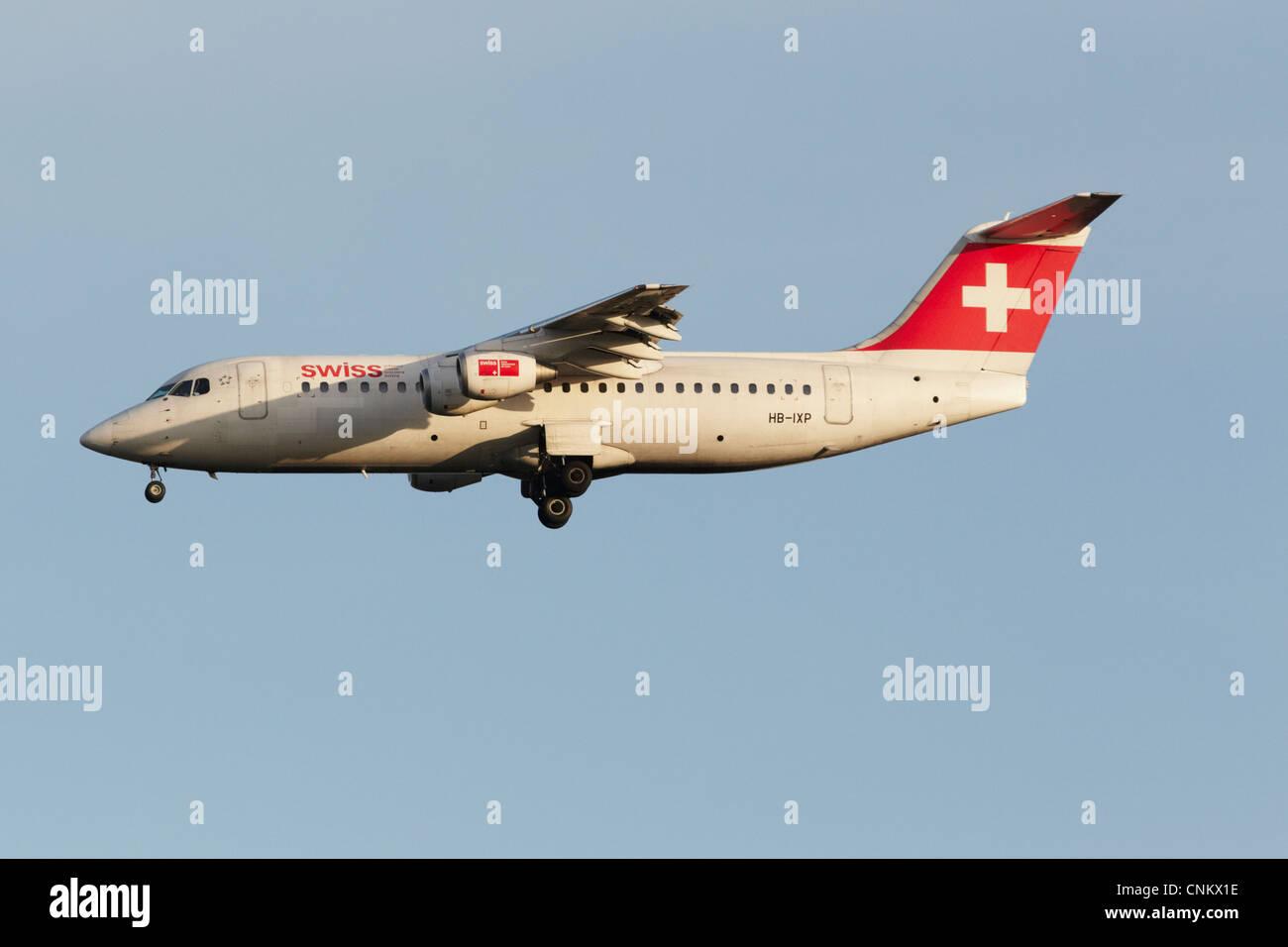 Swiss BAe Avro RJ100 on final approach - Stock Image