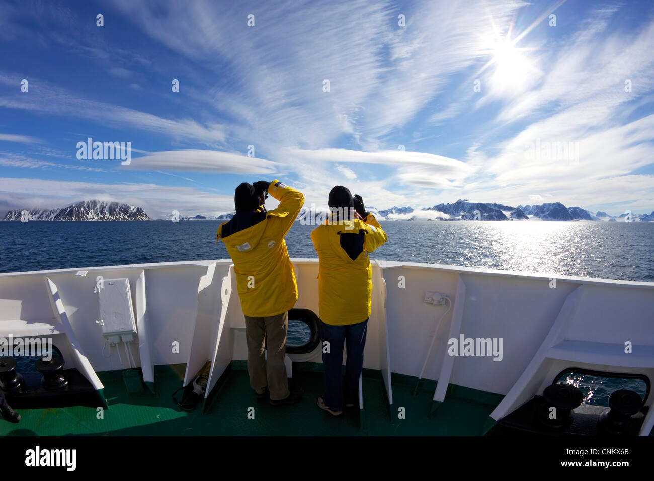 Tourists taking photographs on board the  polar expedition ship, Akademik Sergey Vavilov, of southern Spitzbergen - Stock Image