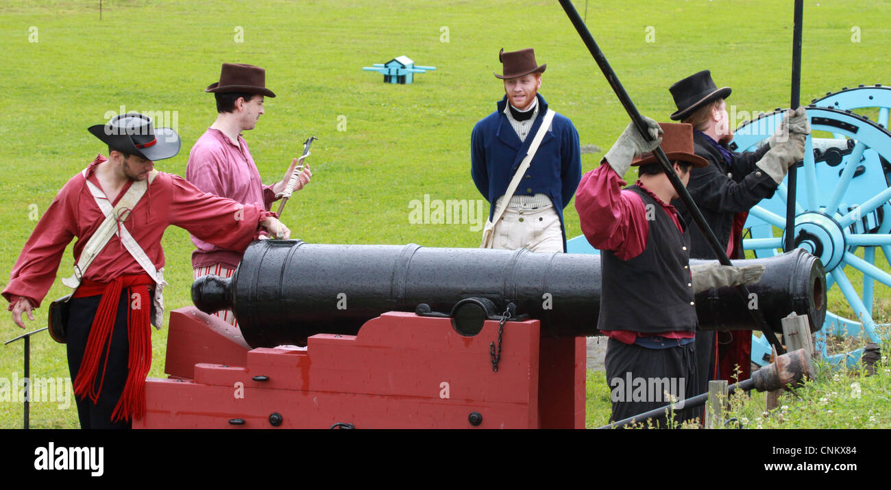 Jean Lafitte's Baratarians reenactors prepare to fire a cannon during The War of 1812 Bicentennial Commemoration - Stock Image