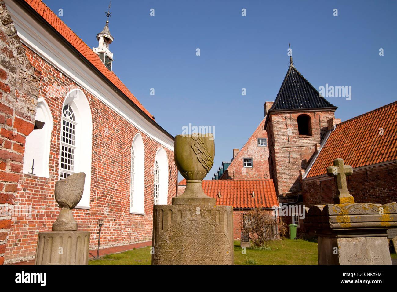 church and cemetery of the East Frisian Siel village Greetsiel, East Frisia, Lower Saxony, Germany Stock Photo