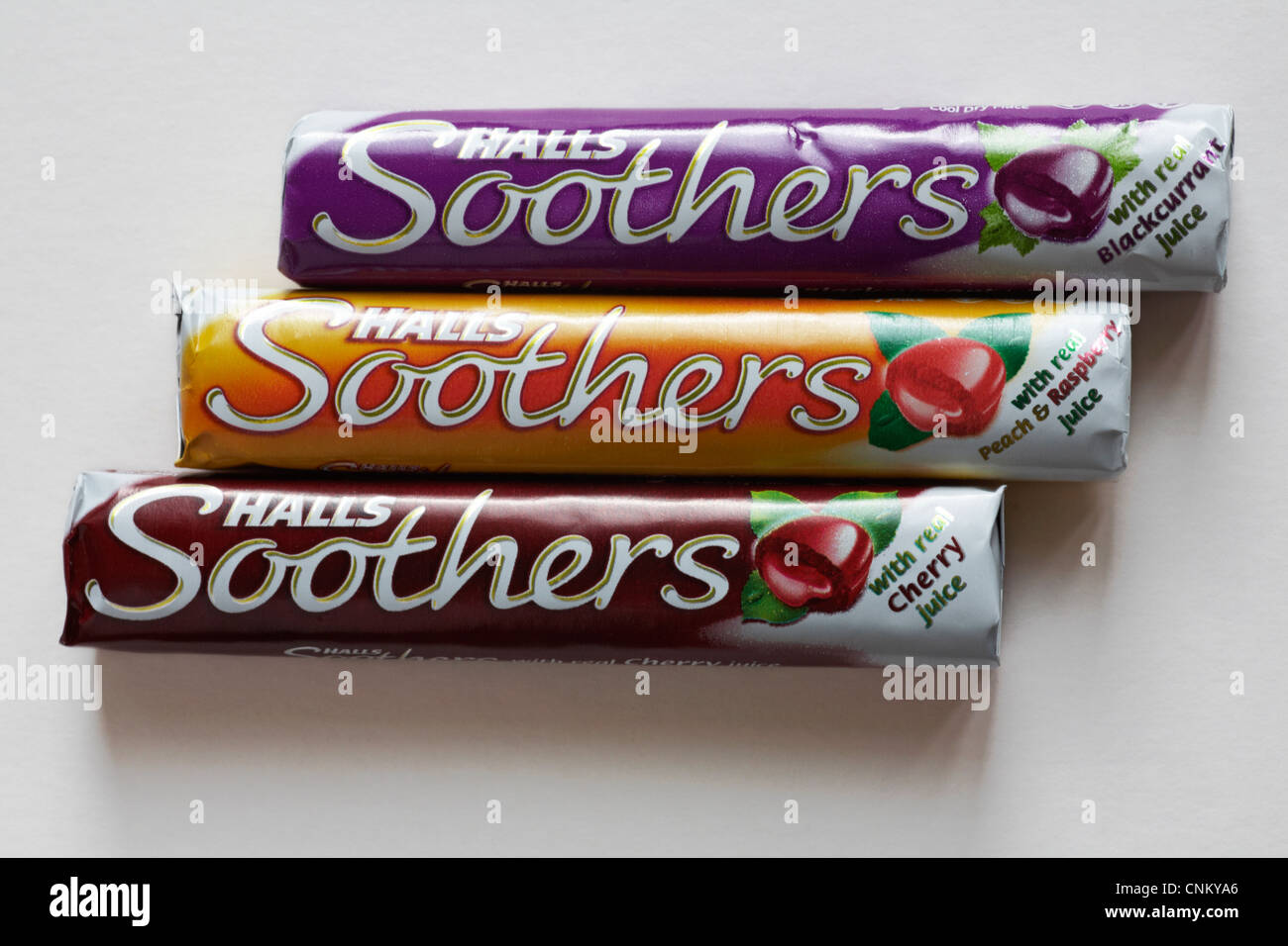 three packets of Halls Soothers sweets - one blackcurrant, one peach & raspberry and one cherry isolated on - Stock Image