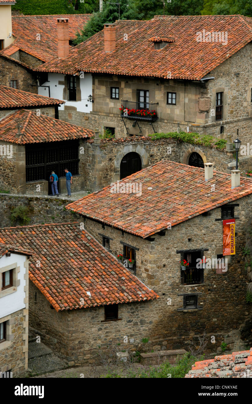 An aerial view of the town of Potes at the foot of the Picos de Europa mountain range in Cantabria Spain - Stock Image