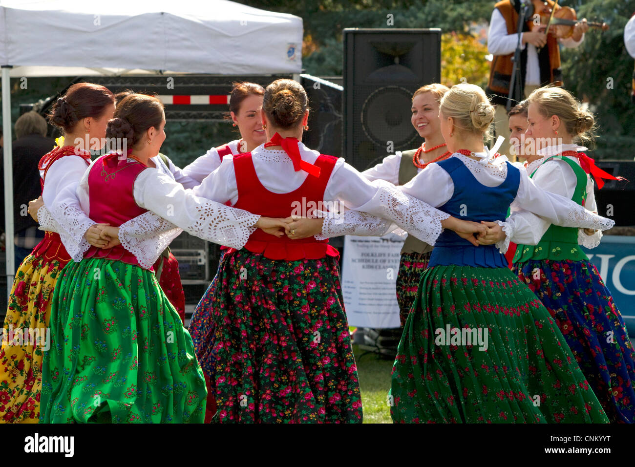 Polish Highlanders folk dancers perform at the Trailing of the Sheep Festival in Hailey, Idaho, USA. - Stock Image