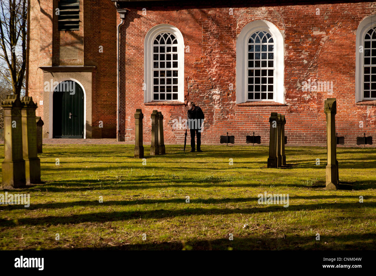 church Friedenskirche and cemetery in Leer , East Frisia, Lower Saxony, Germany - Stock Image