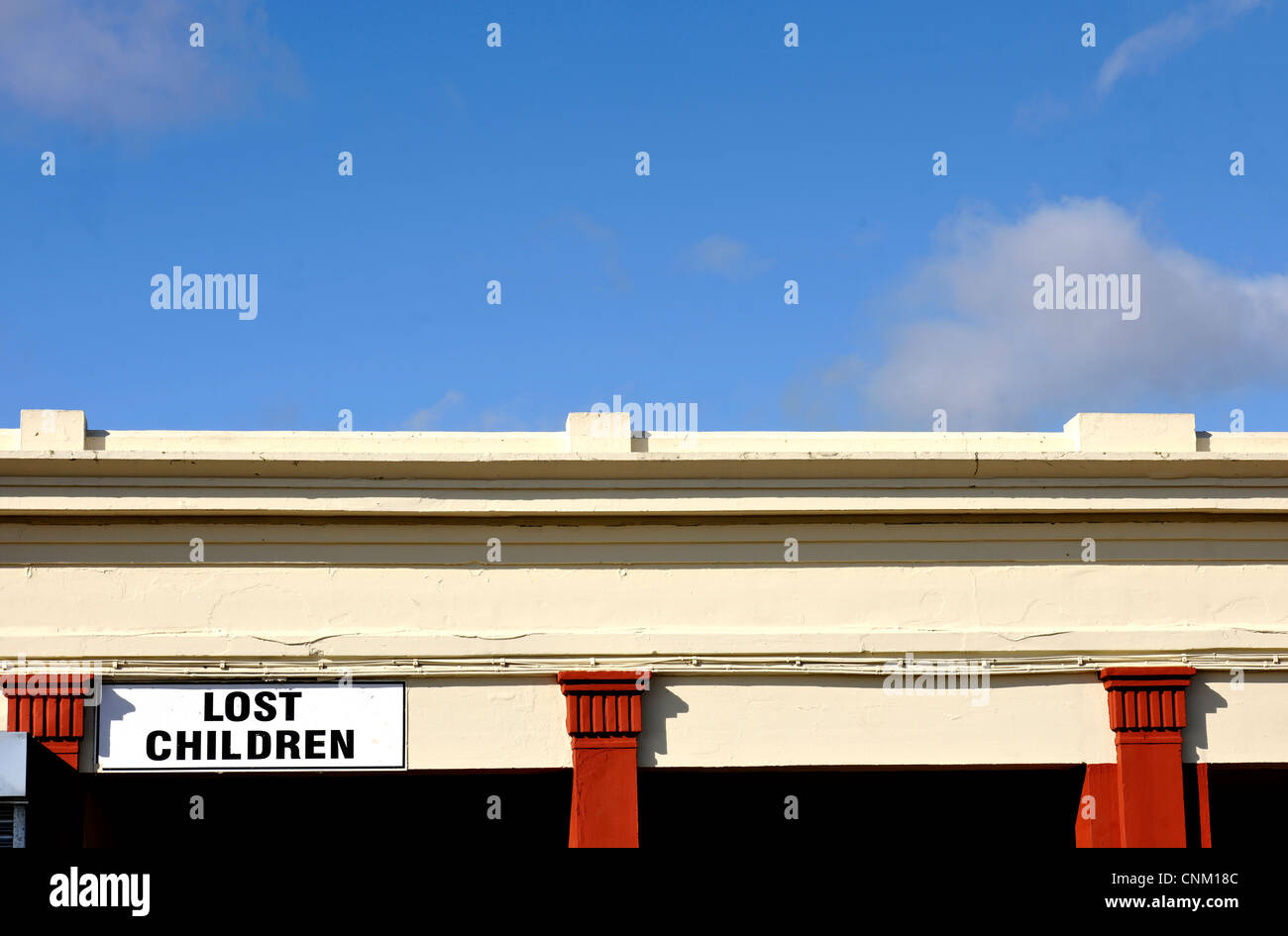 Lost Children sign at seaside resort against a blue sky with white clouds - Stock Image