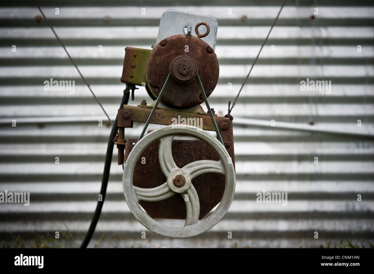 Electric motor pulley rig system for wiring on a farm in front of ...