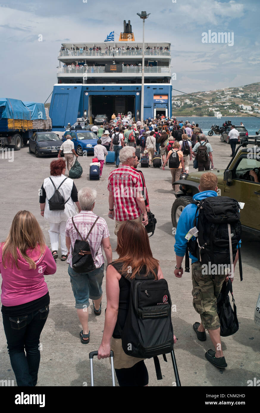 Tourists board a Blue Star ferry on Paros in the Cyclades - Stock Image
