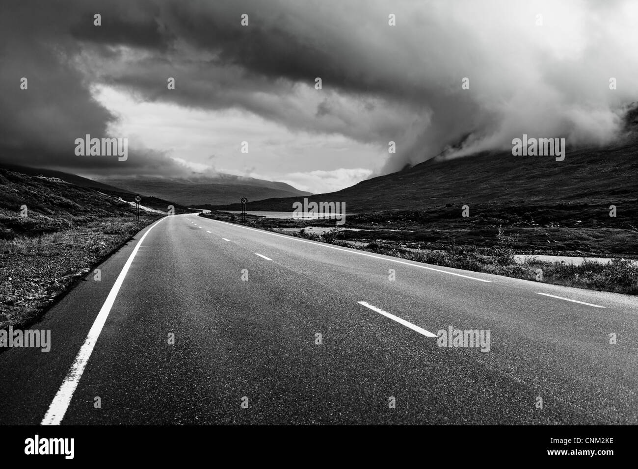 Road perspective black and white colors. Norway. - Stock Image