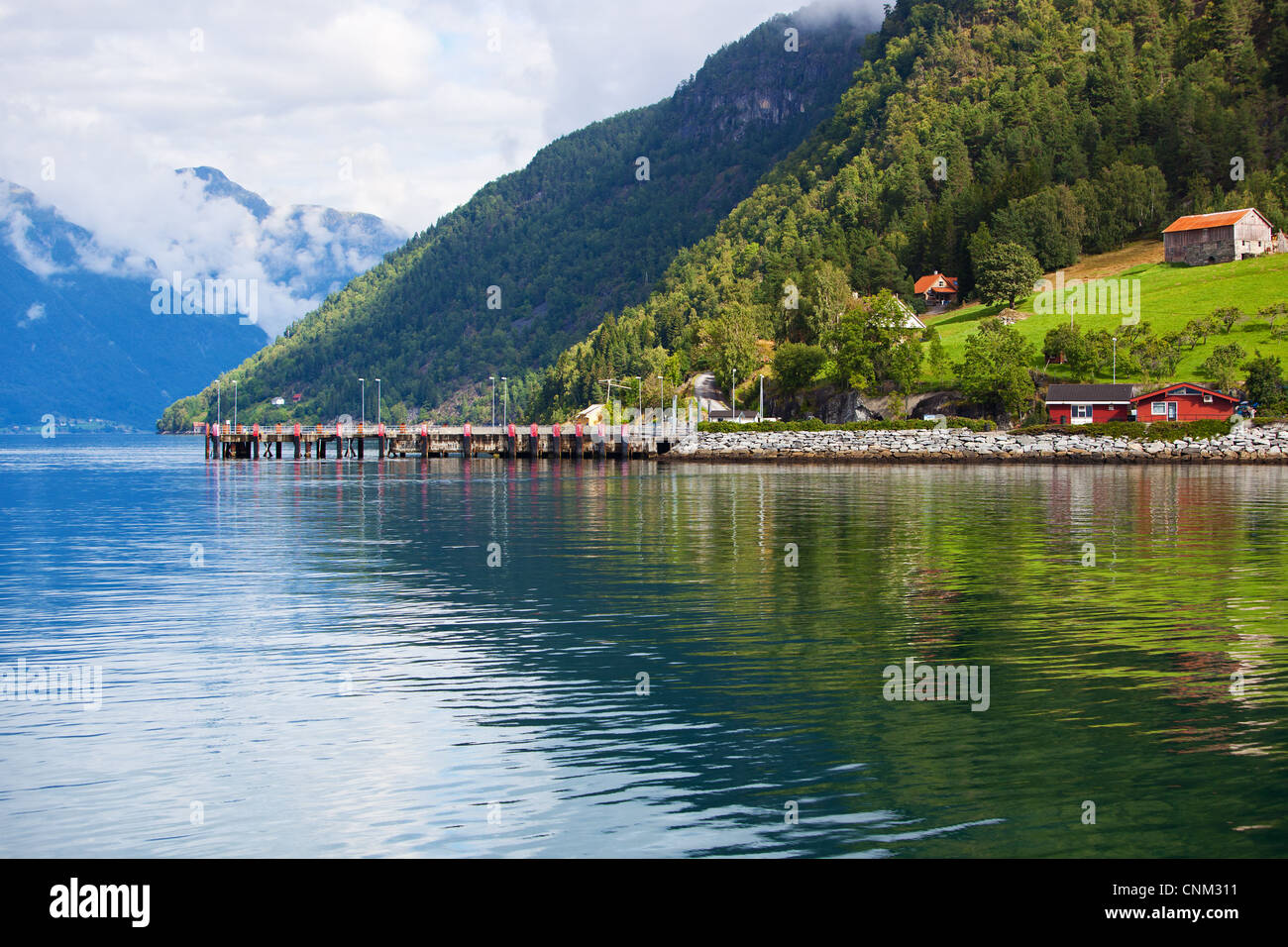 Moorage on fjord shore in Norway. - Stock Image