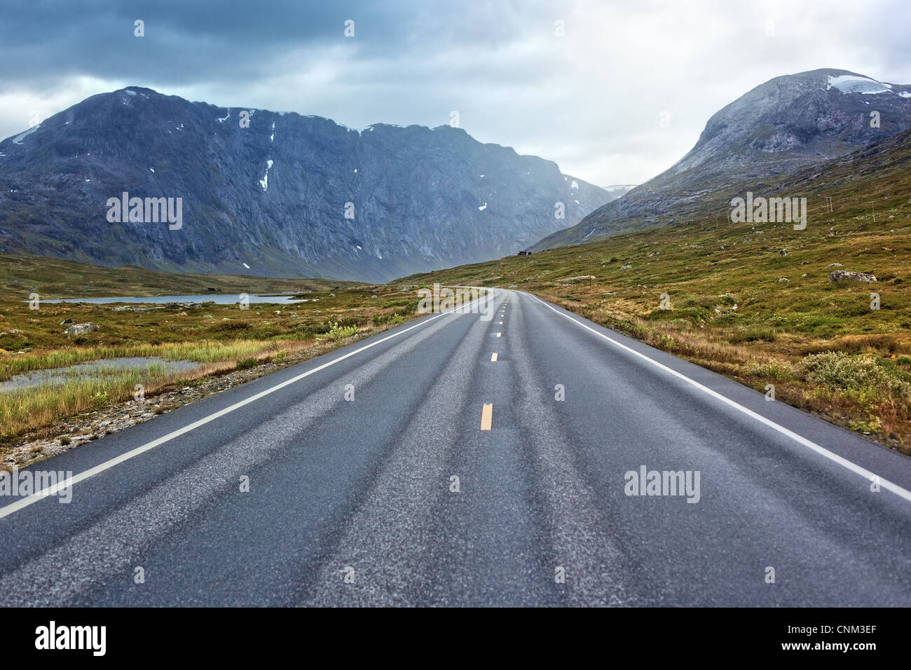 Road perspective in overcast weather. Norway landscape. - Stock Image