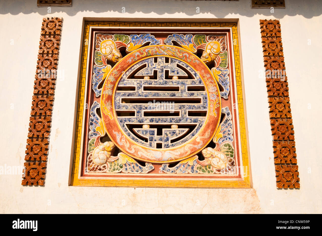 Symbol of longevity on a wall of the Hall of the Mandarins in the Imperial City, Hue, Vietnam - Stock Image