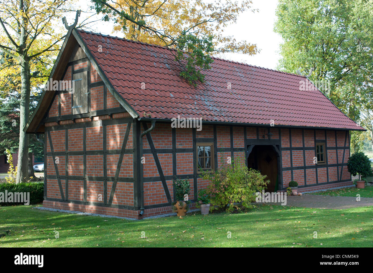 Traditional wood-framed out building Germany - Stock Image