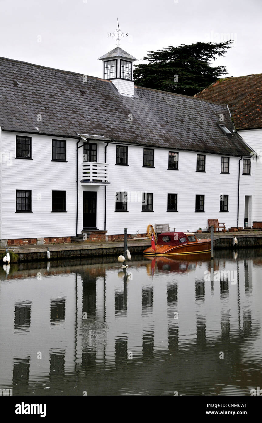 Graphic photo of a row of terraced white cottages on the weir at Hambleden with strong reflections in the River - Stock Image