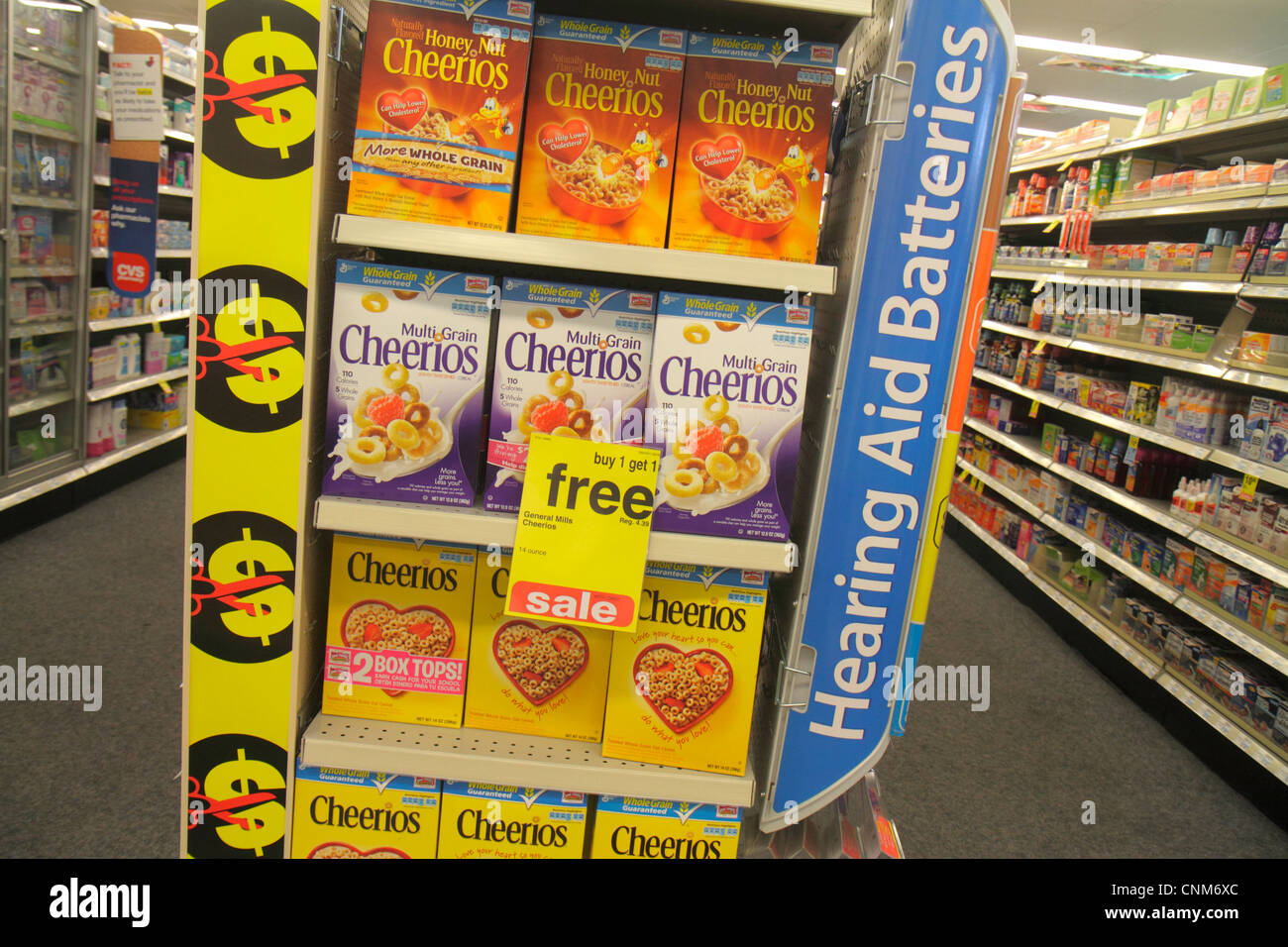 Miami Beach Florida CVS Pharmacy drugstore retail display for sale cereal General Mills Cheerios boxes - Stock Image
