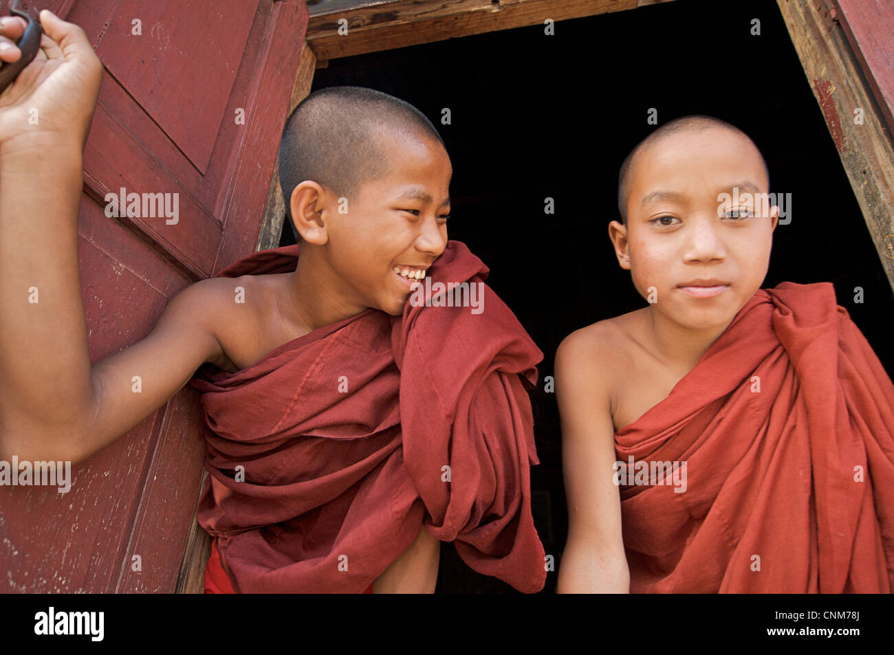 Buddhist monks at window of quarters, Kalaw Monastery, Burma - Stock Image
