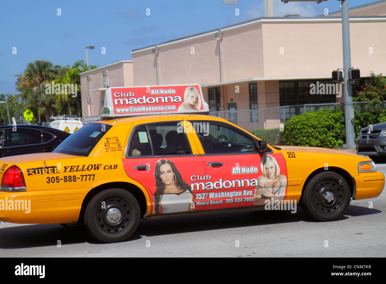 Miami Beach Florida 41st Street taxi cab advertising strip club - Stock  Image