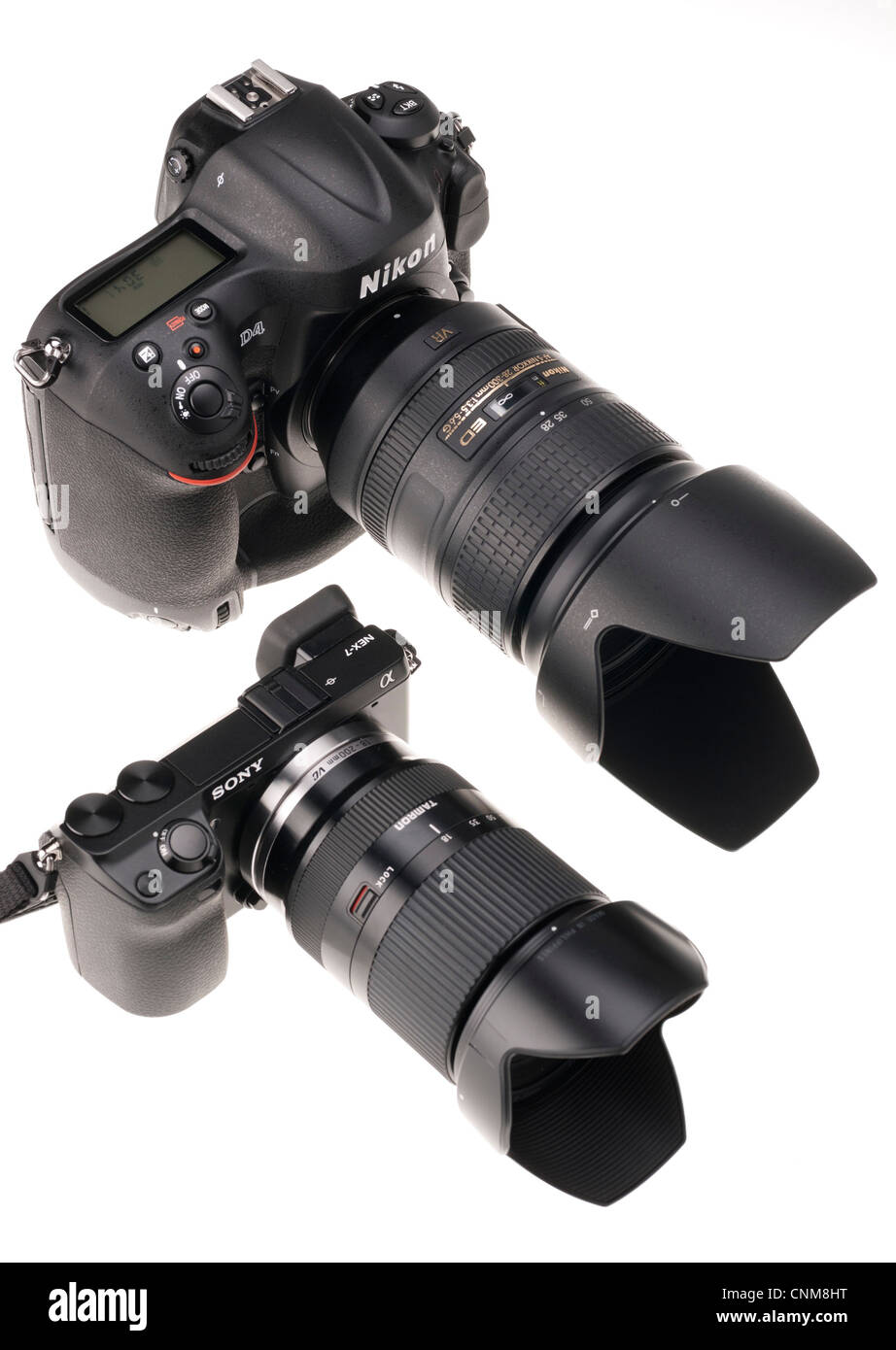 Photographic equipment - Nikon D4 with 28-300mm lens seen beside