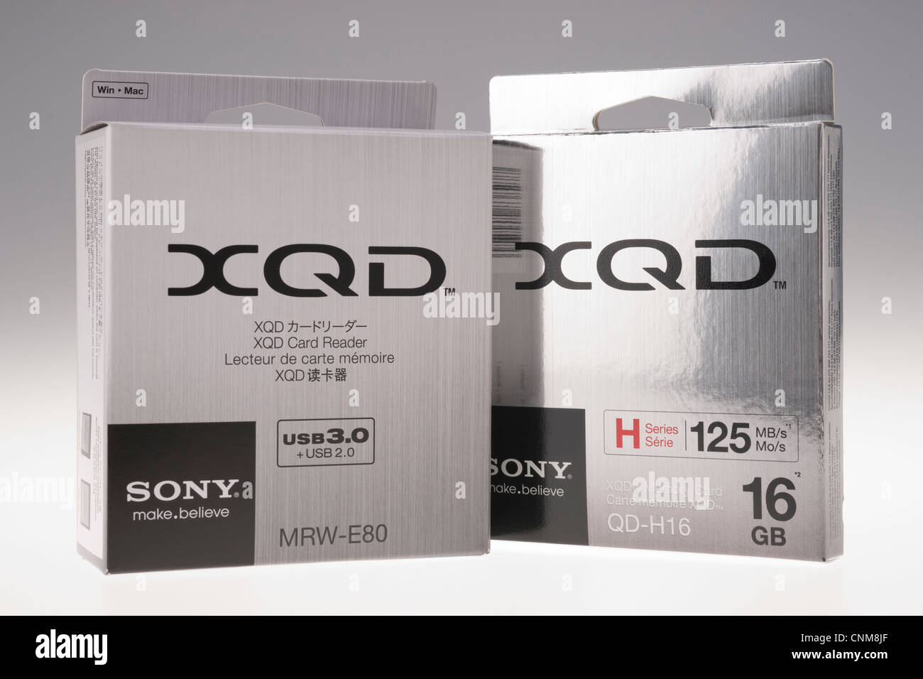 Photographic equipment - Sony XQD memory card. Packaging, card and reader. - Stock Image