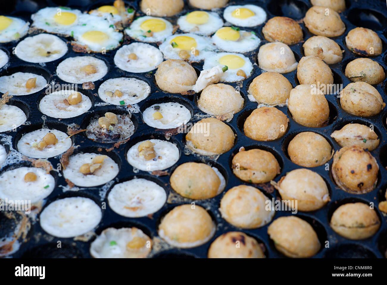 Japanese-like takoyaki. Fried balls with egg. Pyin U Lwin market, Shan State, Burma. Myanmar - Stock Image