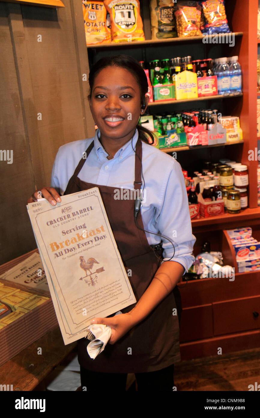 Fort Lauderdale Ft. Florida Cracker Barrel restaurant Black woman menu hostess waitress employee uniform job - Stock Image