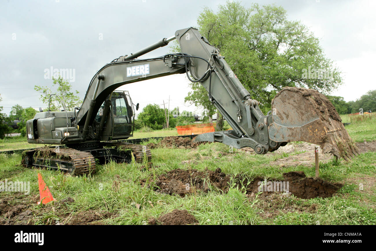 Equipment Operator Third Class Steve Tefft operates a excavator during the construction of a bioswale, Monday, April Stock Photo