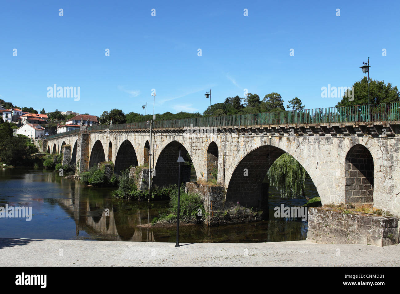 The medieval arched stone bridge across the River Lima at the town of Ponte da Barca, Minho, Portugal, Europe - Stock Image