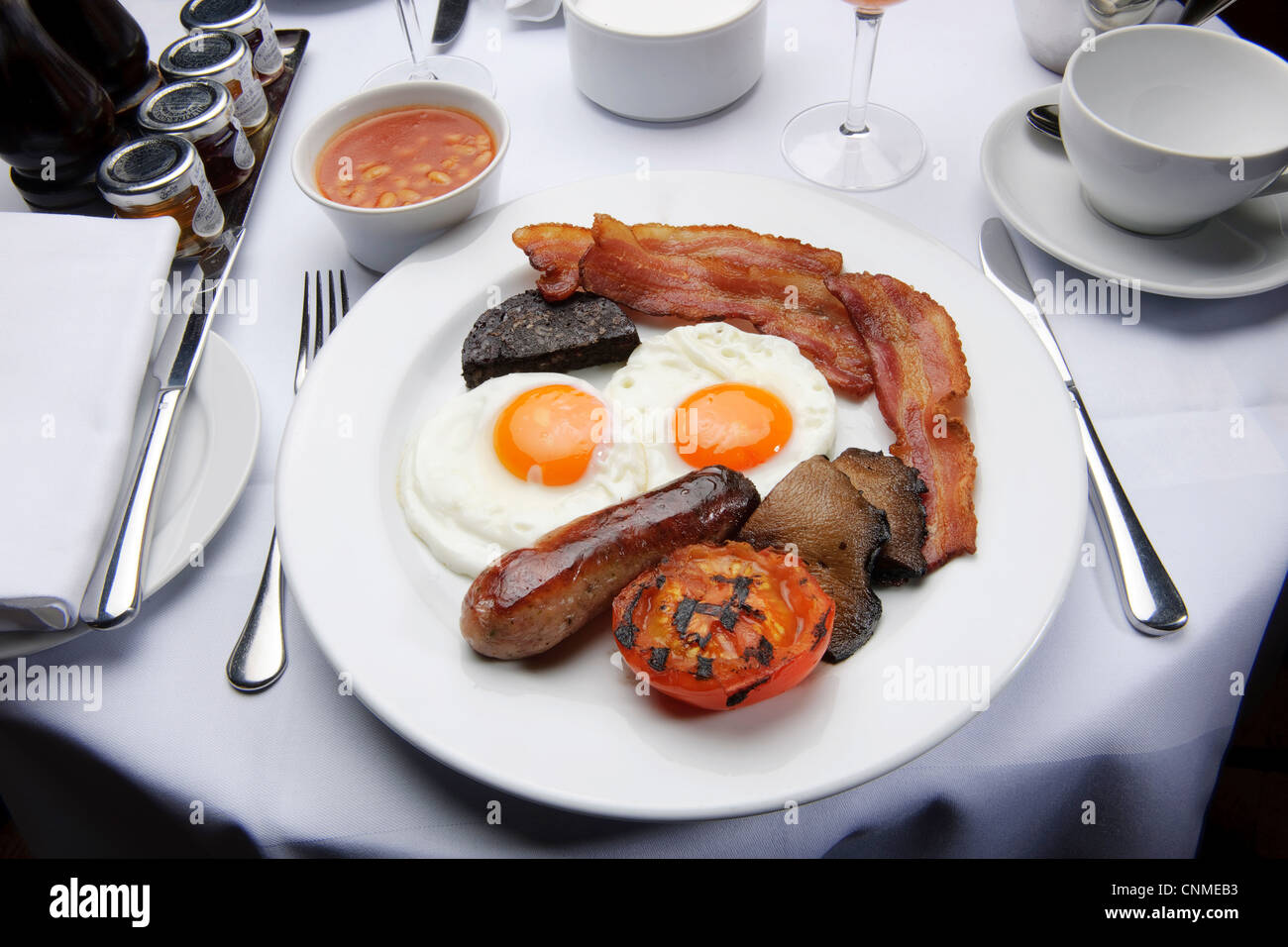 full english breakfast bacon and eggs fry-up in restaurant healthy unhealthy Stock Photo
