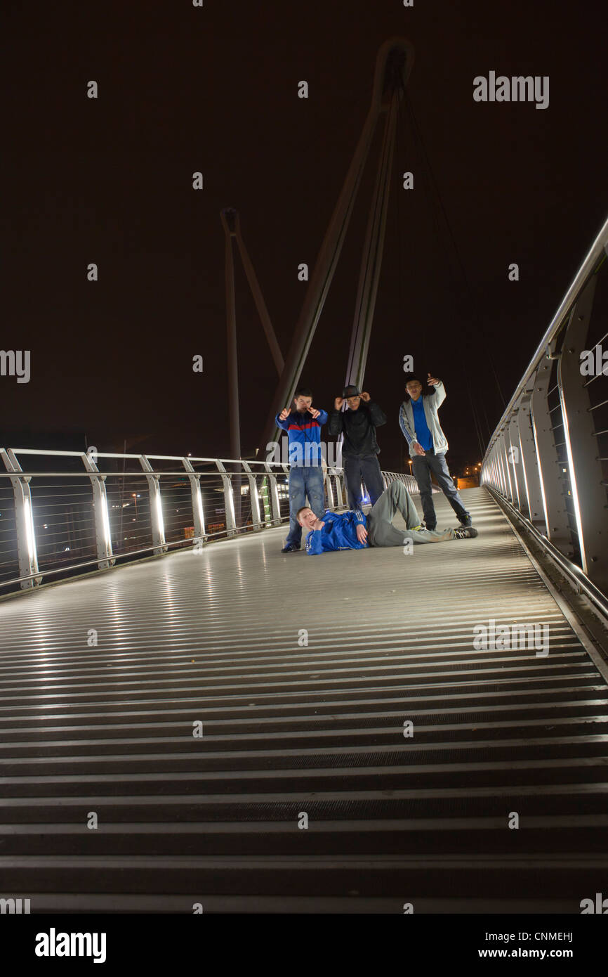 The corporation road crew on the millennium footbridge over the river Usk in Newport city center. - Stock Image