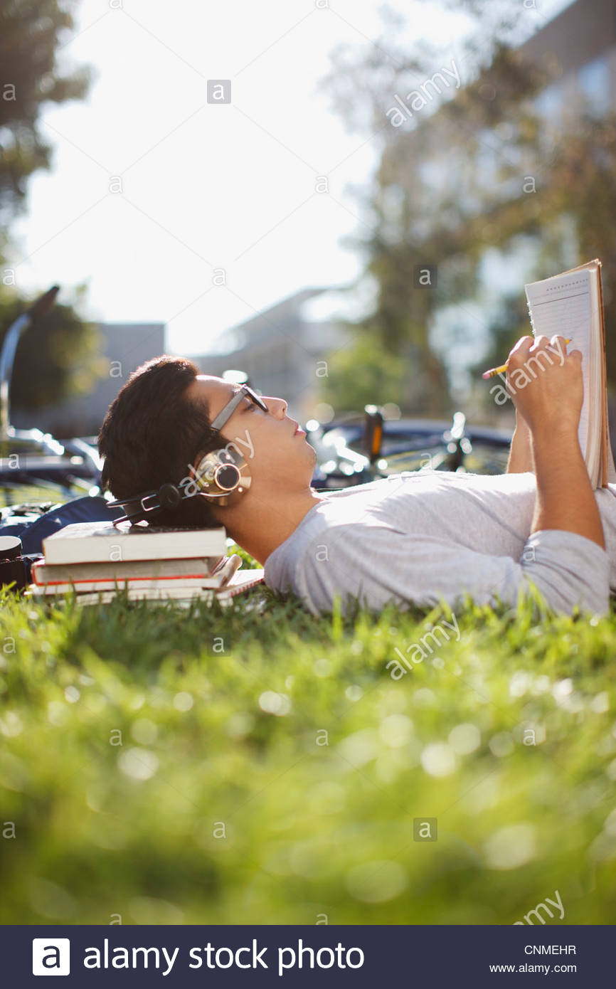 Student studying outdoors - Stock Image