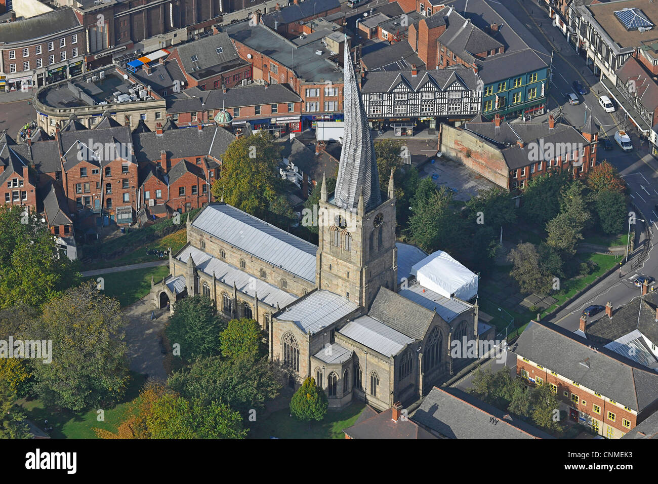 Aerial photograph showing the Church of Saint Mary and All Saints in Chesterfield with its twisted spire. - Stock Image