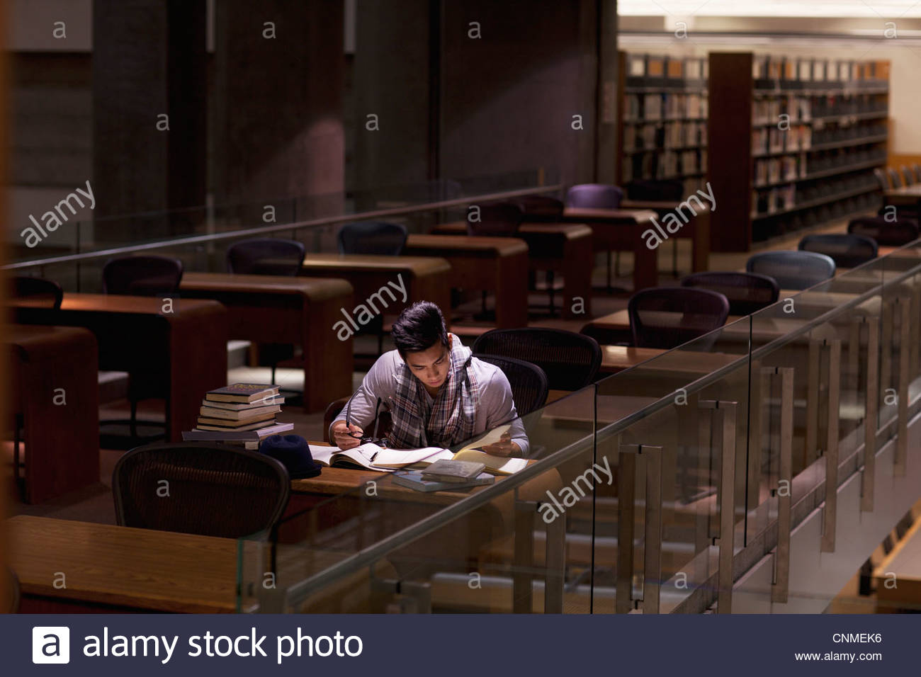 Student working in library at night Stock Photo