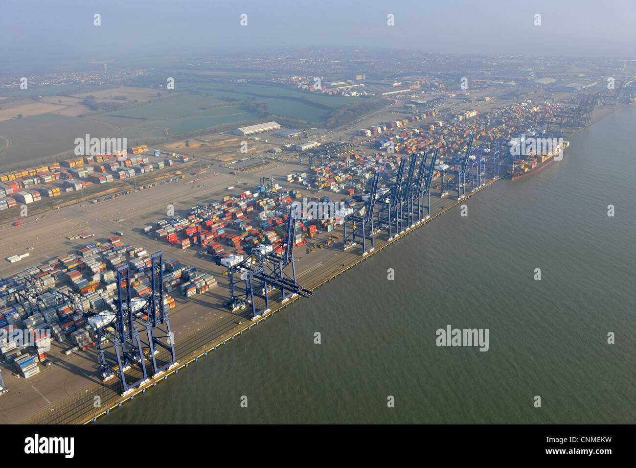 Aerial photograph showing Felixstowe docks with ship in port, cargo containers and cranes. - Stock Image