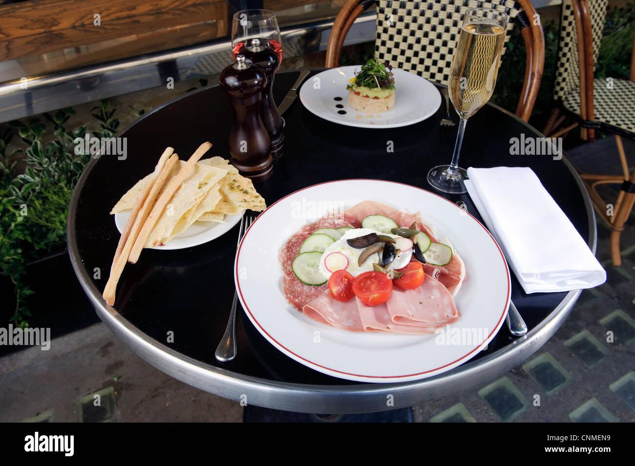 posh single restaurant meal on table outside - Stock Image
