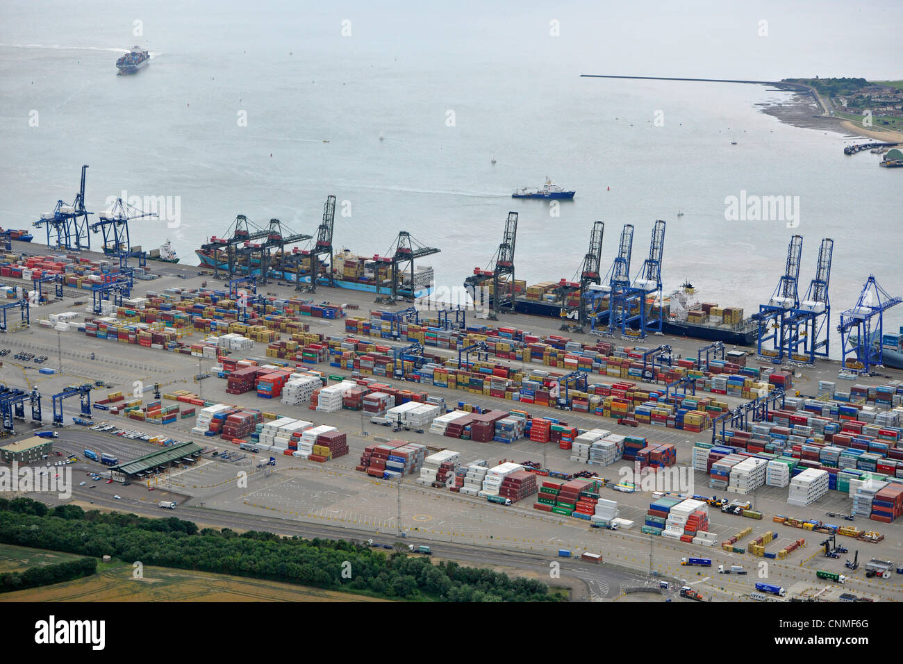 Aerial Photograph showing Felixstowe docks with shipping containers, cranes and ships in port. - Stock Image