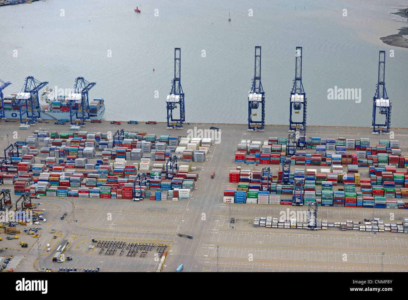 Aerial Photograph showing Felixstowe Docks with shipping containers and cranes. - Stock Image
