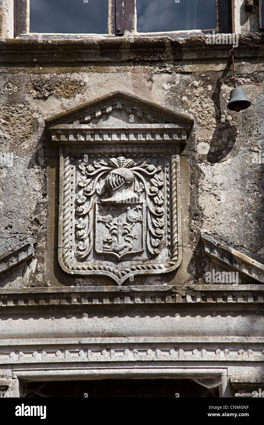 Family crest with knight's helmet above door of house in Cite de la Couvertoirade, Aveyron, France - Stock Image