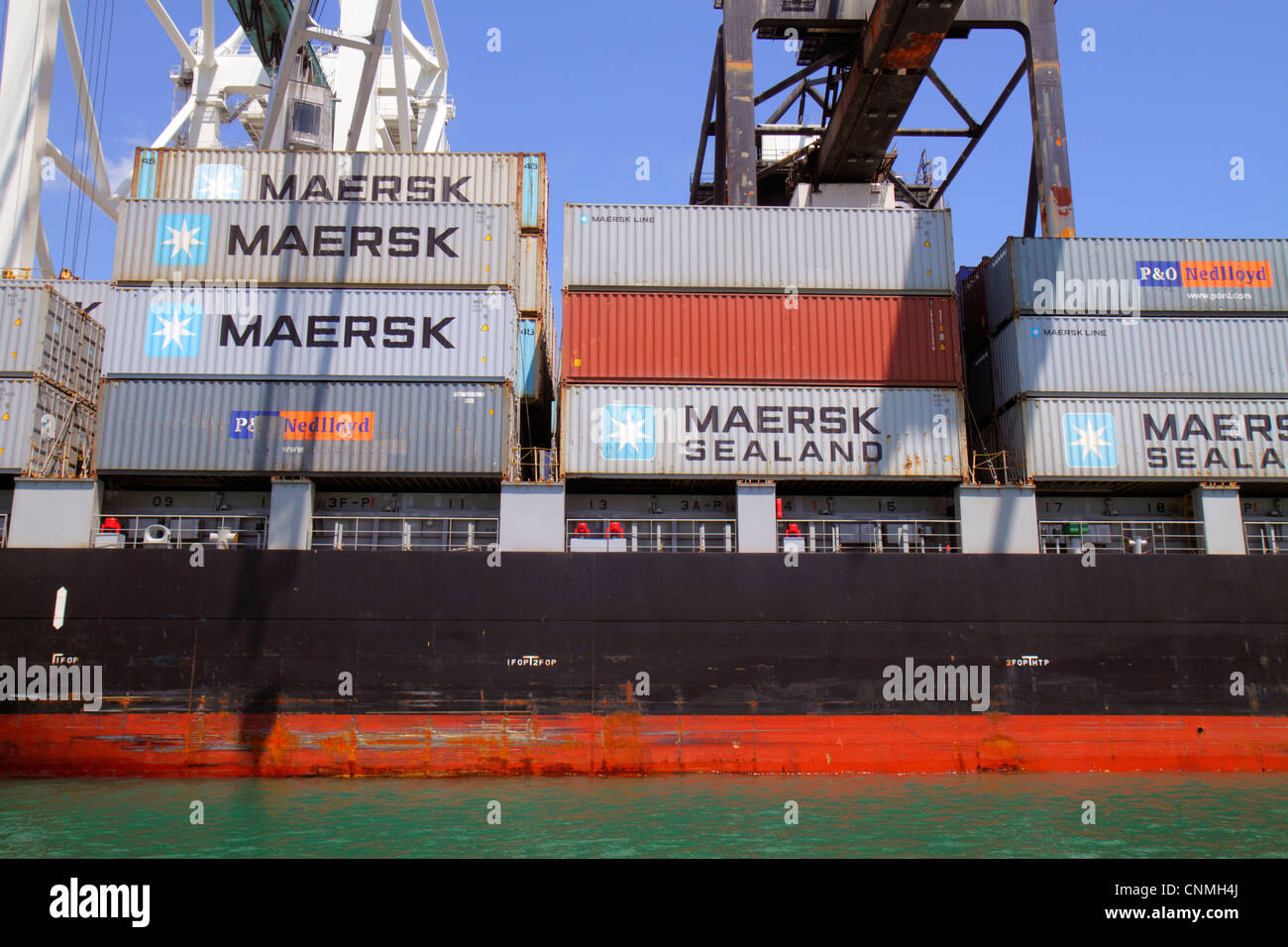 Miami Florida Biscayne Bay Port of Miami Dodge Island cargo container ship cranes Maersk Sealand - Stock Image