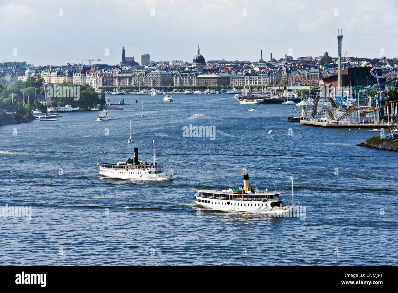 Swedish steam cruise vessels S/S Storskär &  Blidösund are leaving Stockholm harbour on a cruise in - Stock Image