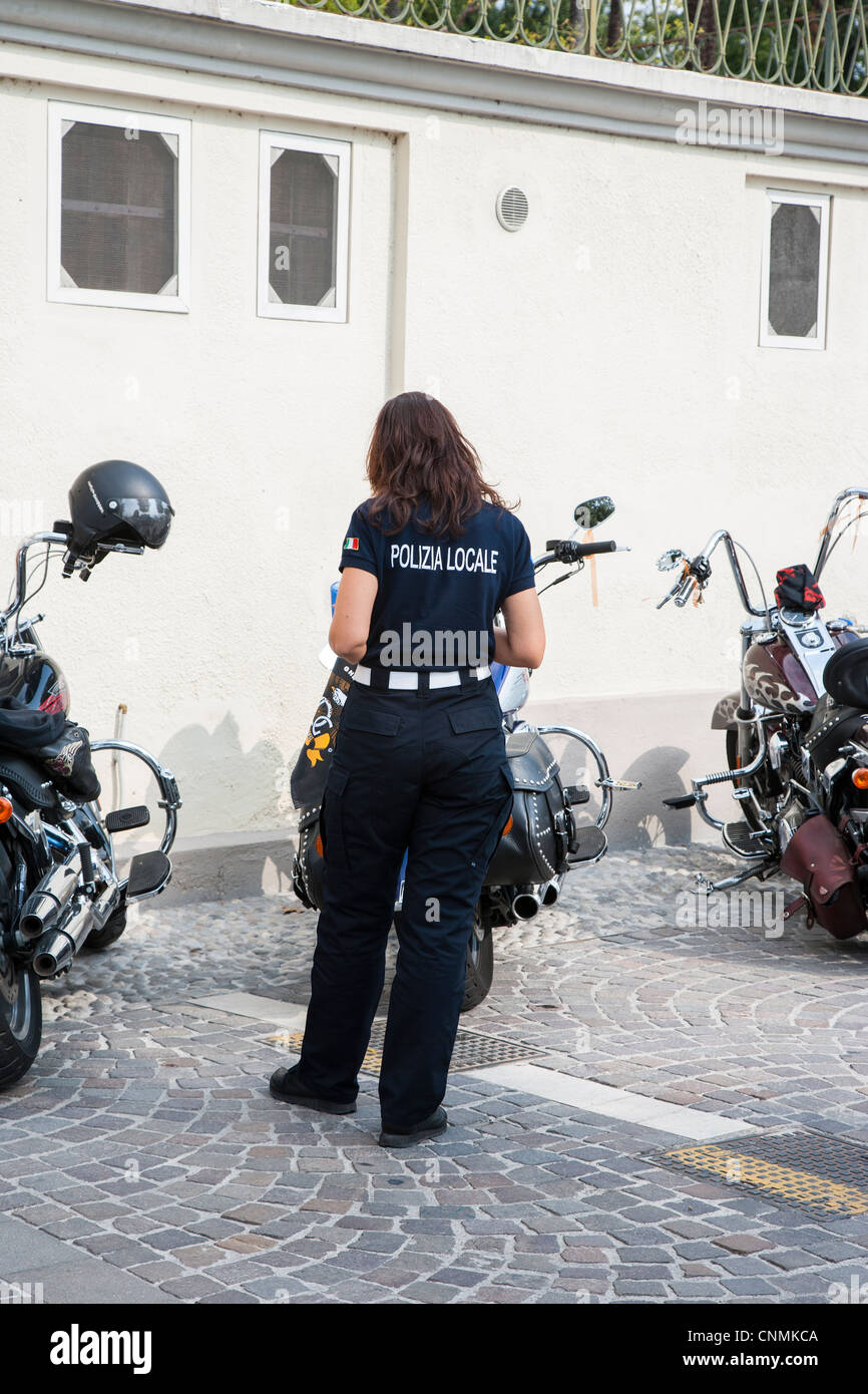 Police woman checking motorbikes in Italy - Stock Image