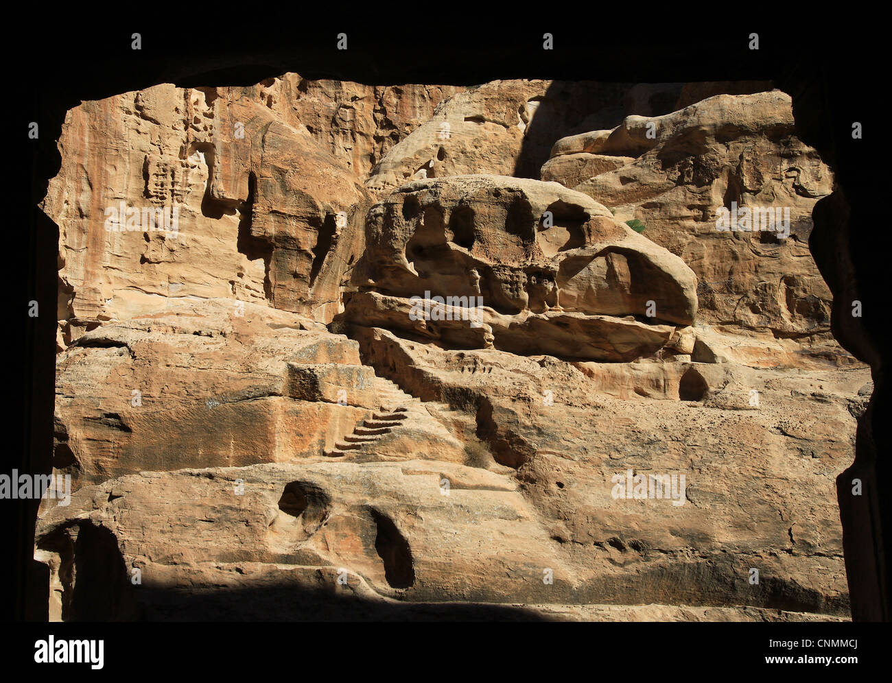 Cliff formations of the Siq al-Barid showing remains of the Nabatean culture seen from a cave in Little Petra. Beidha, Stock Photo