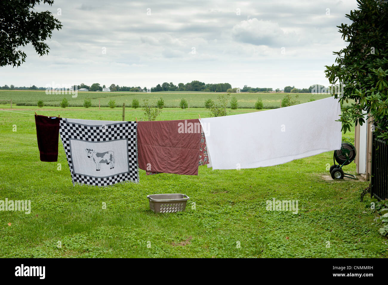 Linens hanging on a clothesline on a farm in Maryland - Stock Image